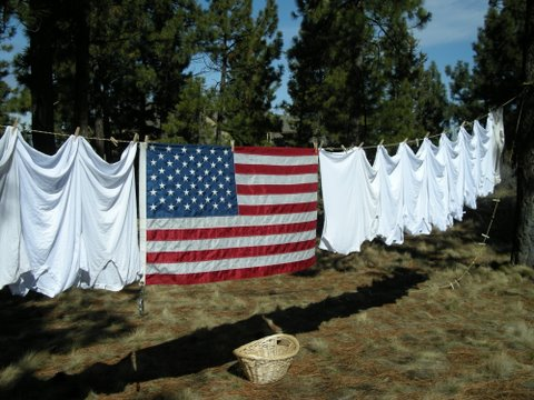 2009march-clothesline-and-American-Flag_permission-by-Susan-Taylor
